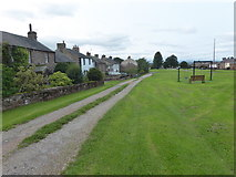 NY6529 : Looking down The Green at Milburn by Marathon