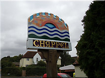TL8928 : Chappel Village sign on The Street by Adrian Cable