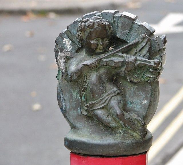 Cherub bollard finial by St Benedicts Gate