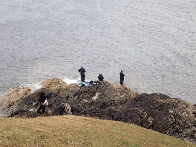 Fishing off the rocks near Porth y Cychod