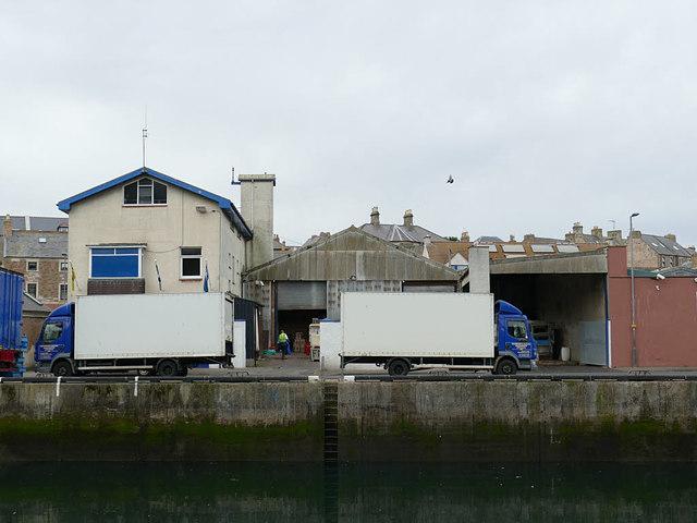 Vans loading at FMA, Eyemouth quayside