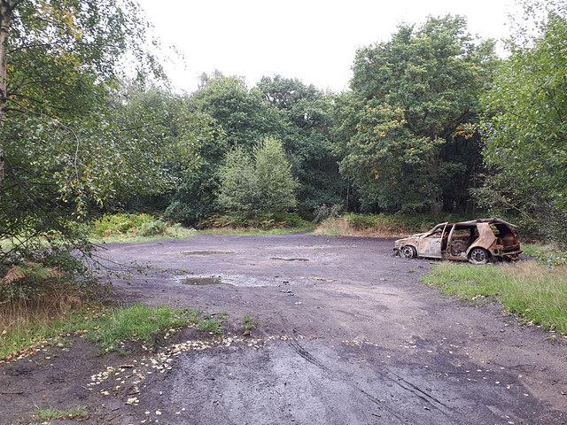 Burnt-out car in Halton Moor Wood