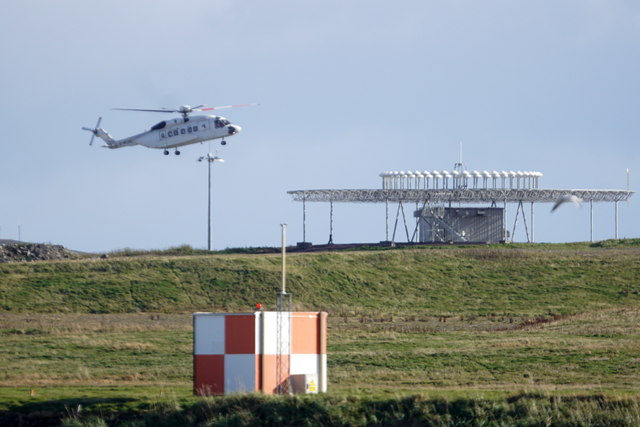 Helicopter landing at Sumburgh Airport, from Virkie
