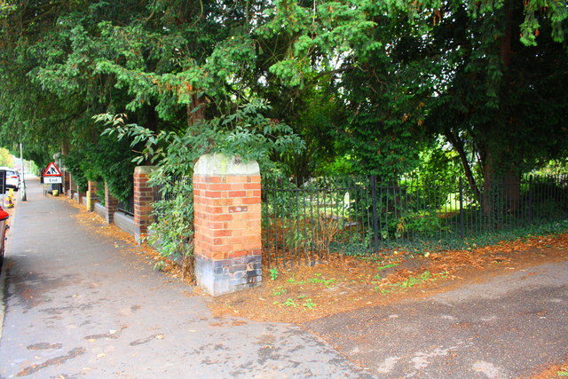 Wall bounding cemetery beside New Road
