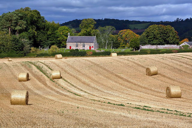 A stubble field with bales at Maxton