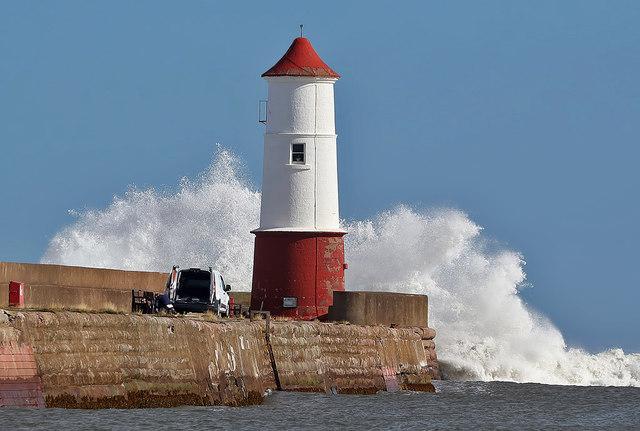A big wave hits Berwick-upon-Tweed Lighthouse