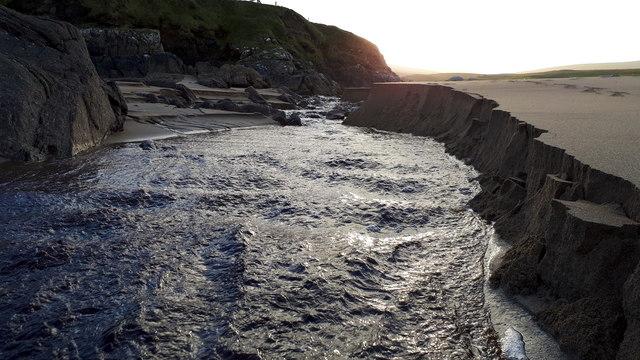 Burn of Skaw cutting through the sand on Skaw beach