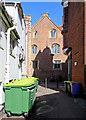 TL4458 : Laundress Lane: bins and bricks by John Sutton