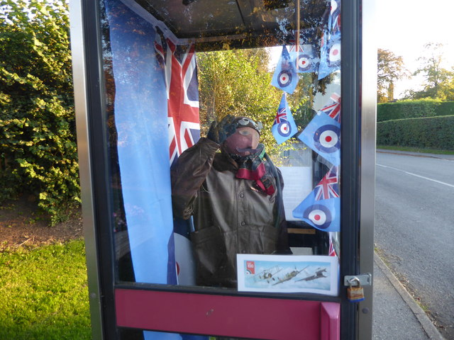 A close up of the airman in the telephone box at Upton