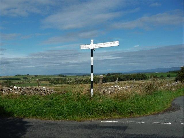 Cumbrian signpost at a 326 metre spot height