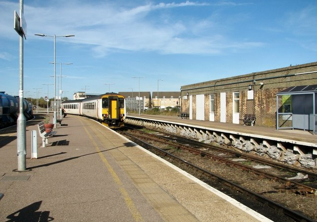 A Diesel multiple unit arrives at Great Yarmouth railway station by Evelyn Simak