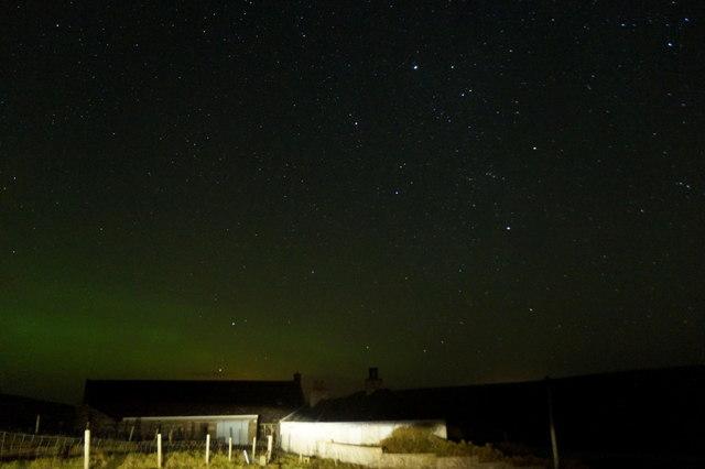A fading aurora borealis over Houlland, Baltasound