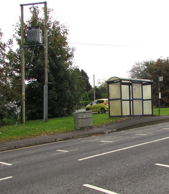 Line spur pole near an A4061 bus stop and shelter, Bryncethin