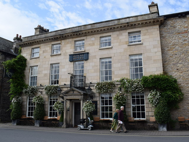 Walking past the Royal Hotel, Kirkby Lonsdale