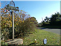TM4098 : Norton Subcourse Village Sign by Adrian Cable