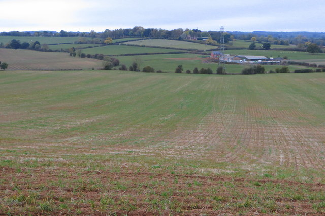 Field sloping down to the farm