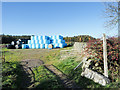 NY9576 : Route of public footpath past bales by Trevor Littlewood