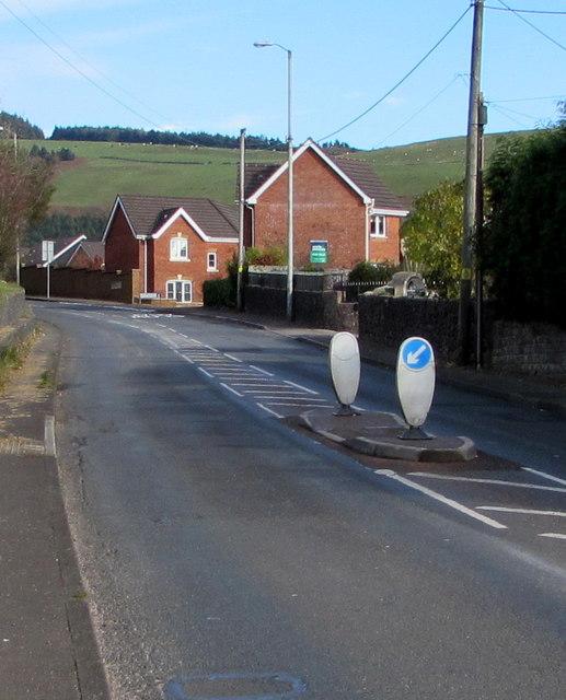 Keep left sign on a pedestrian refuge in Lewistown