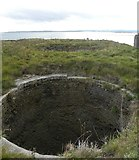 NU1341 : Bowl of old lime kiln on Holy Island by Gordon Hatton
