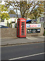 TL8528 : Telephone Box on the A1124 High Street by Geographer