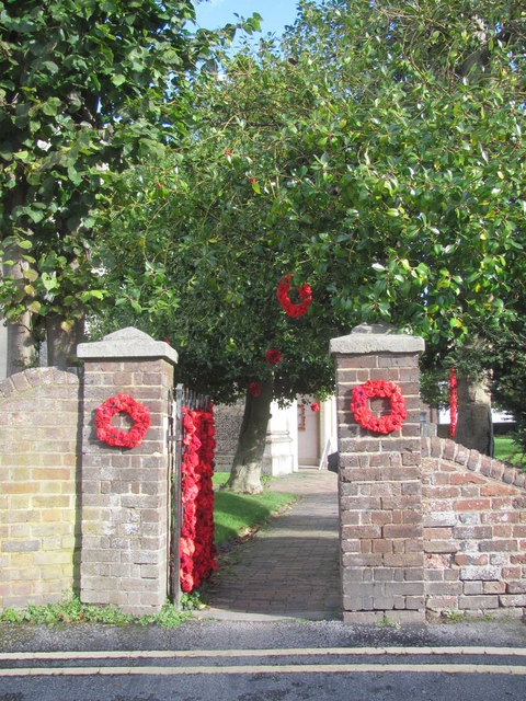 Poppy Wreaths at the side gate of Tring Church for Armistice Day