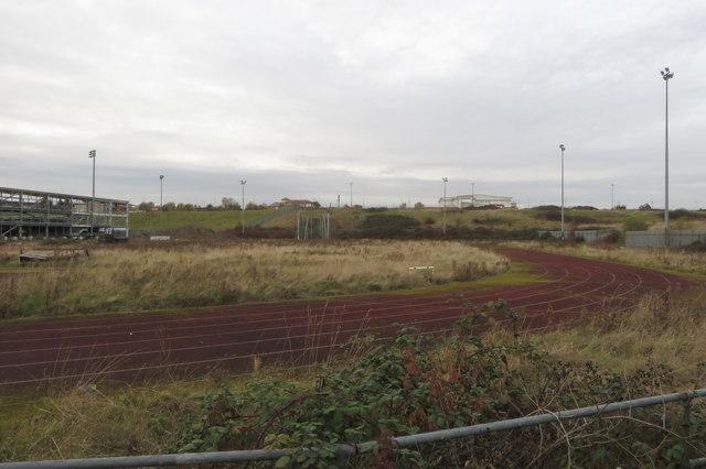 Unkempt athletics track next to the football stadium