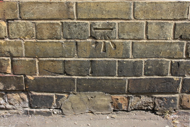 Benchmark on #97 Eastfield Road (Padholme Road face)