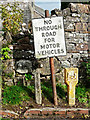 NY4335 : Old traffic sign and marker posts for water by Rose and Trev Clough