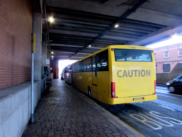 Yellow Manchester coach at bus stop Q2, Queensway, Newport