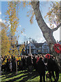 SP9211 : ... While many stand in the Churchyard for the service at the war memorial by Chris Reynolds