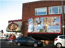 TG5307 : Disused hoarding in Lancaster Road by Evelyn Simak