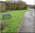 SS9388 : Roadside bench at the southern edge of Ogmore Vale by Jaggery