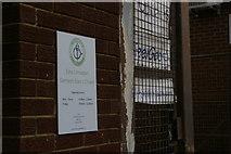 TQ2486 : Door sign, Ezra Umarpeh Ltd., Granville Road by Christopher Hilton