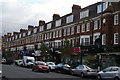 TQ2487 : Shopping parade, Golders Green Road by Christopher Hilton