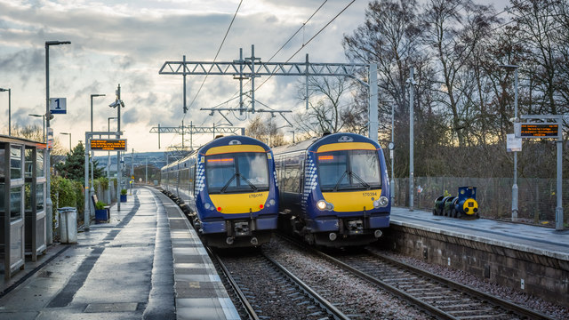 Two class 170s crossing at Bridge of Allan Station