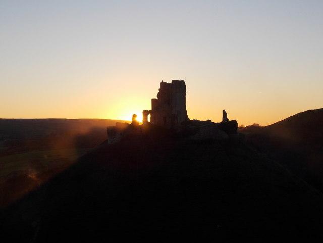 Corfe Castle: steam surrounds the castle at sunset
