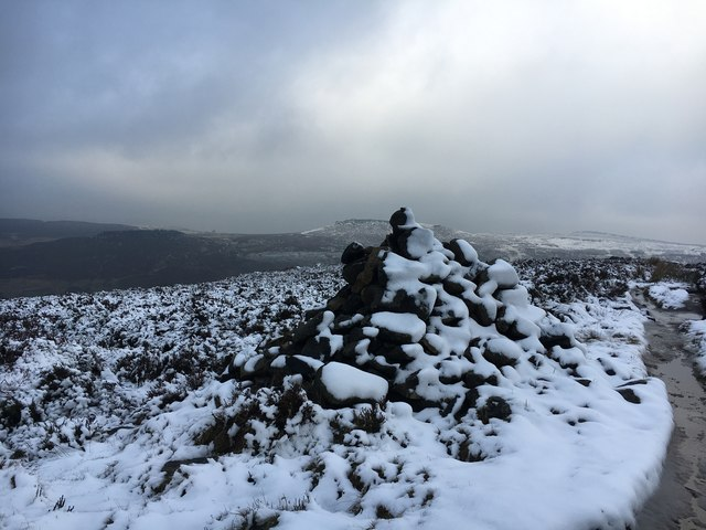Snow-covered cairn on Burbage Edge