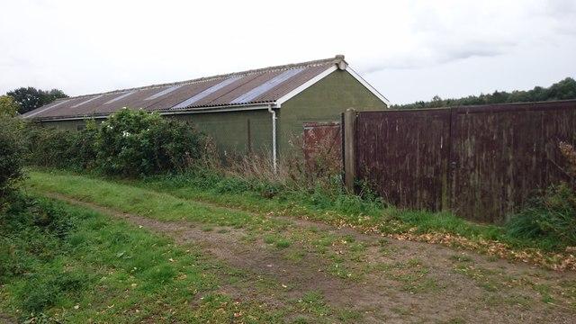 Farm building next to footpath