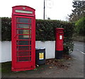 SE2445 : Elizabeth II postbox and phonebox on Main Street, Pool in Wharfedale by JThomas