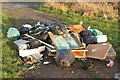NZ3173 : Flytipped rubbish in a field gateway by Graham Robson