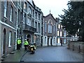 TF4609 : Police outriders waiting for Charles and Camilla in The Crescent, Wisbech by Richard Humphrey