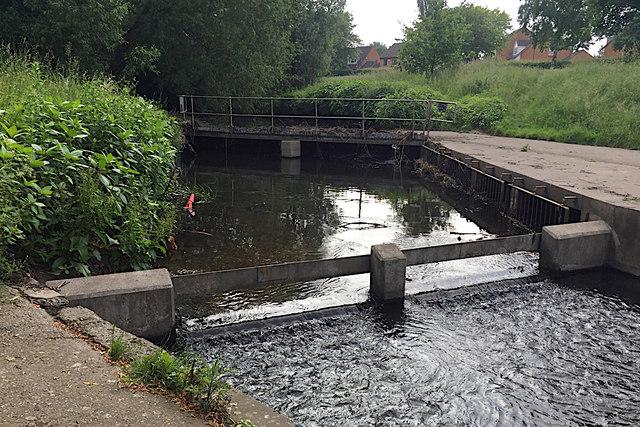 Weir and footbridge on the Kingshurst Brook, Chelmsley Wood, east Birmingham
