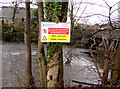ST1493 : Notice on a bank above the Rhymney River, Ystrad Mynach by Jaggery