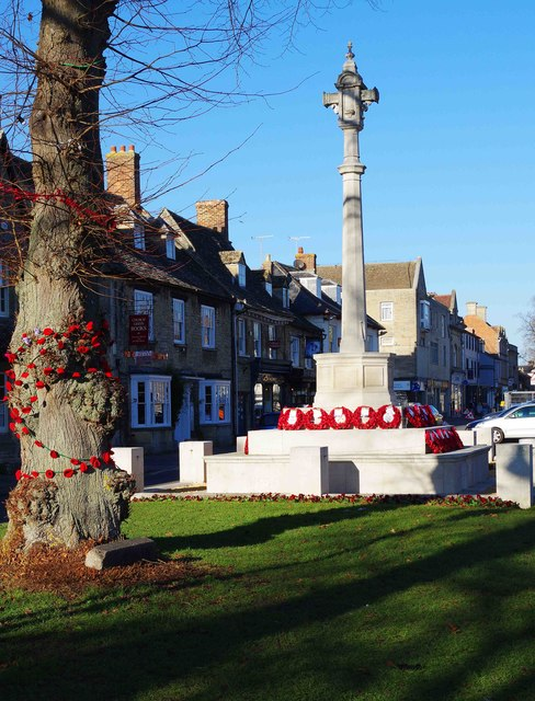 Decorated tree and poppy wreaths on War Memorial, Church Green, Witney, Oxon