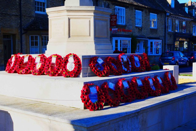 Close view of wreaths around War Memorial, Church Green, Witney, Oxon