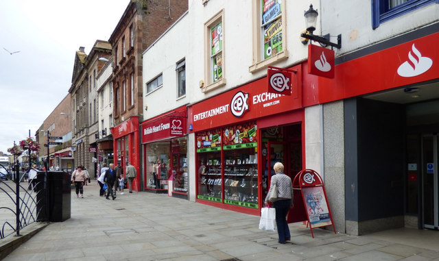 A row of red fronted shops on Ayr High Street