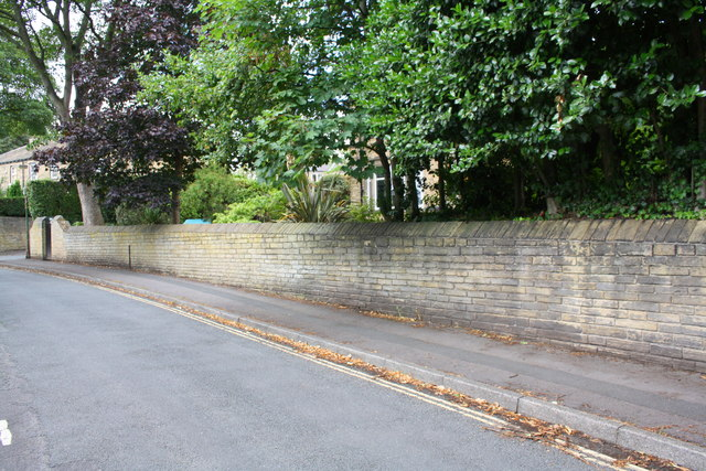 Wall on north side of High Street approaching Manley Street junction