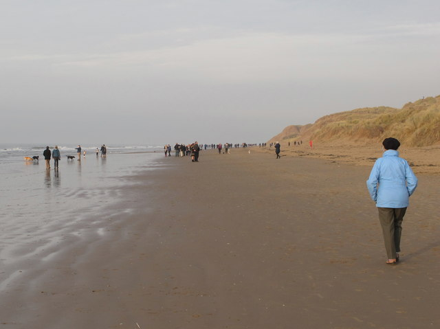 Walkers on sands at Formby Point, Boxing Day 2018