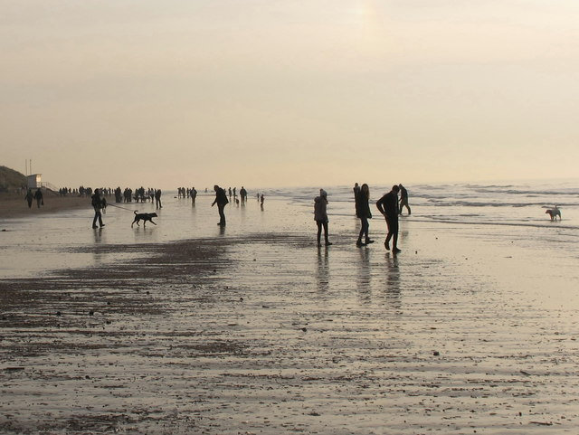 Formby Point, walkers seen against the light