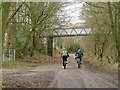 SJ9460 : Cyclists on the railway trail by Stephen Craven